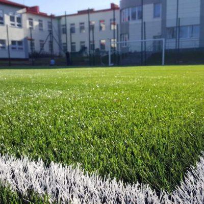 Closer look at FIFA Pro-grade system moduliq football field showing high-density artificial turf.